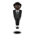 Man in Business Suit Levitating: Dark Skin Tone on Apple iOS 10.3