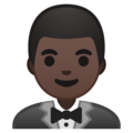 Man in Tuxedo: Dark Skin Tone on Google Android 8.1